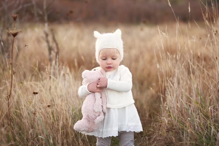 sweet little girl cuddling toy