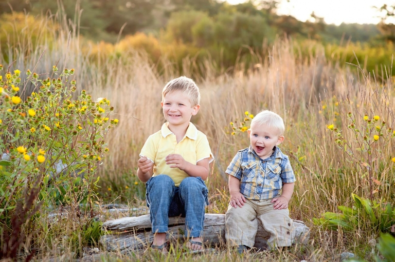 cute and candid portrait of two brothers laughing