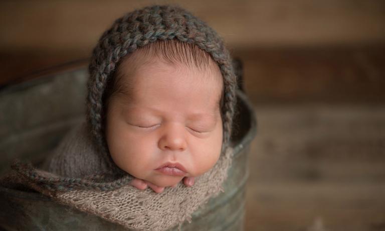 newborn baby wearing handmade knits