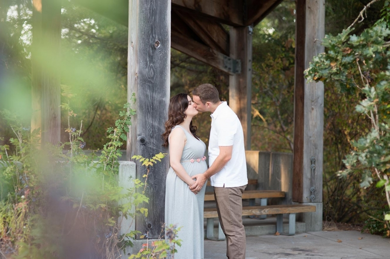 kissing couple expecting baby
