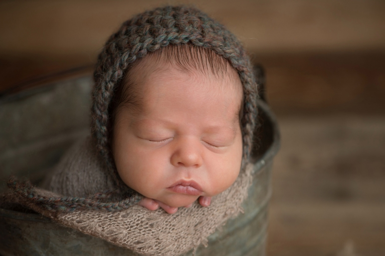newborn wearing hand knits